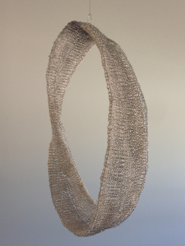 Continuity, 3D textile, Beading wire and silk lace yarn, Hand knitting. 43 cm x 19 cm x 12 cm.